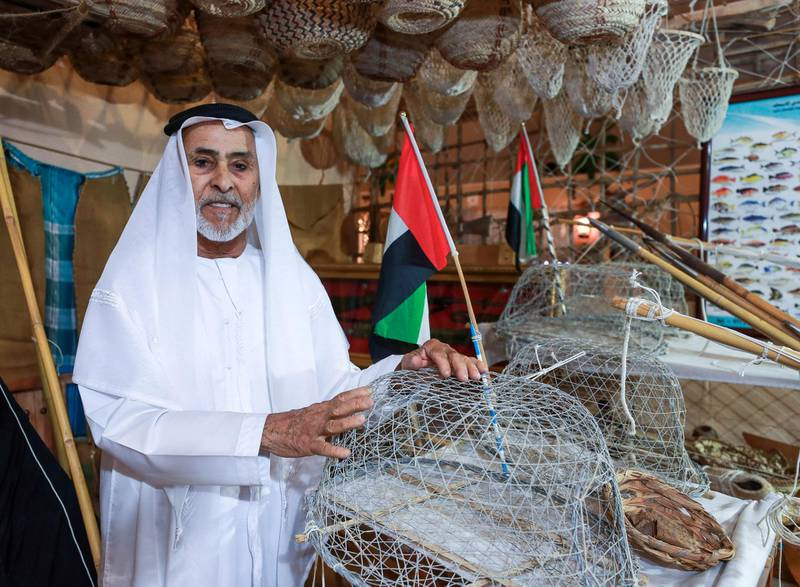 Abu Dhabi, U.A.E., July 18, 2018.  First day of the 2018 Liwa Date Festival. --  Jumaa Hathbour Al Romaithi proudly shows of his Emirati Heritage collection of fishing tools, old coins, knives, picture frames and other collectors items.Victor Besa / The NationalSection:  NAReporter:  Haneen Dajani