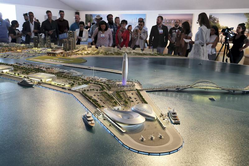 DUBAI , UNITED ARAB EMIRATES , February 26 – 2019 :- Media looking at the model of Dubai Harbour at the Dubai International Boat Show held in Dubai. ( Pawan Singh / The National ) For News/Instagram/Big Picture. Story by Nick Webster