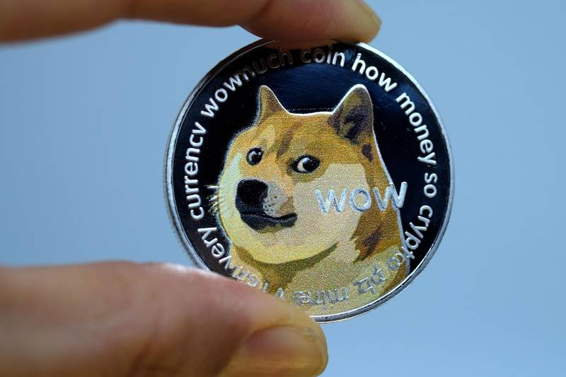 KATWIJK, NETHERLANDS - JANUARY 29: In this photo illustration a visual representation of digital cryptocurrency, Dogecoin is displayed on January 29, 2021 in Katwijk, Netherlands.  (Photo by Yuriko Nakao/Getty Images)