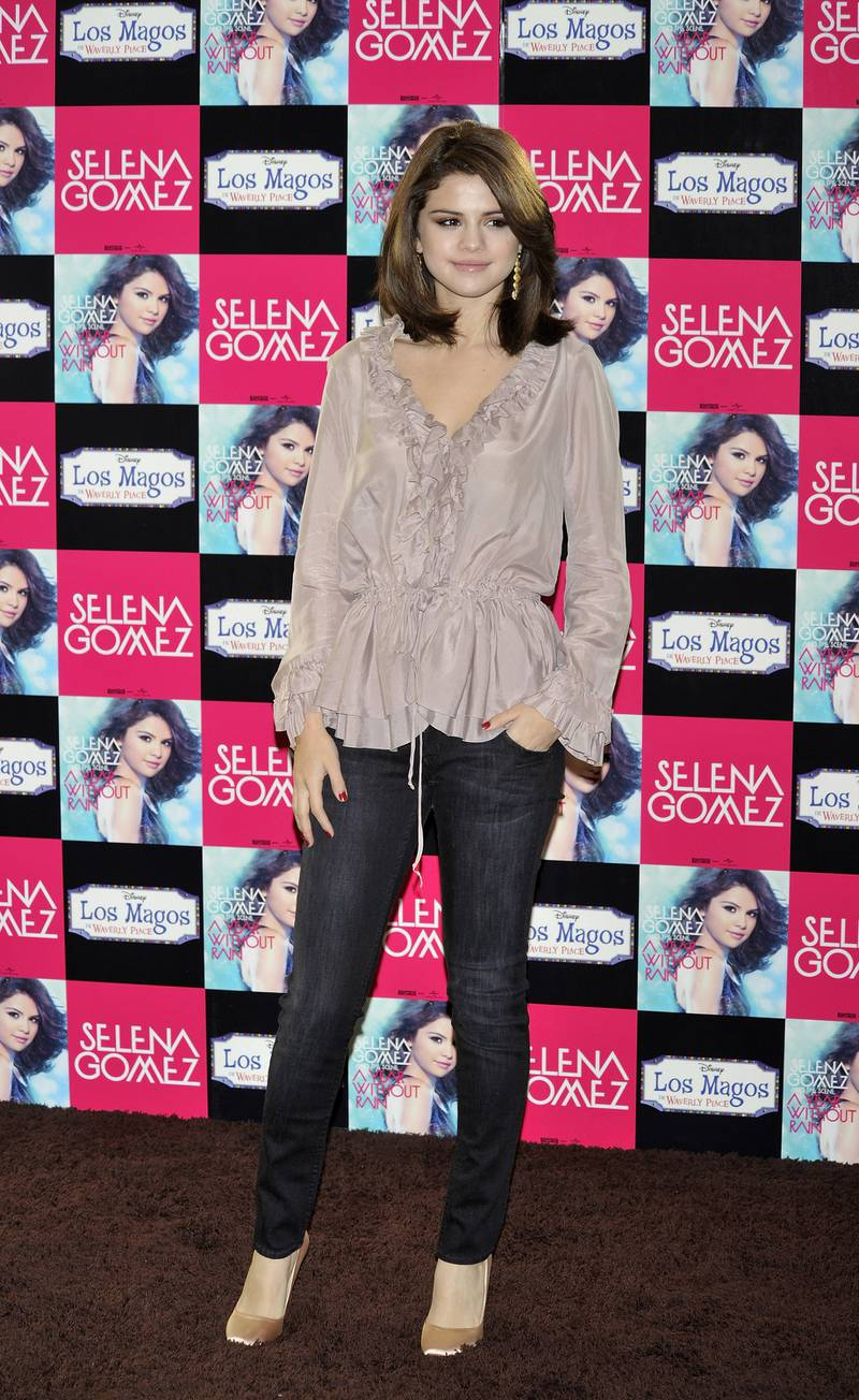 """MADRID, SPAIN - OCTOBER 18:  Singer and actress Selena Gomez presents her new album """"A Year Without Rain"""" at the ME Hotel on October 18, 2010 in Madrid, Spain.  (Photo by Carlos Alvarez/Getty Images)"""
