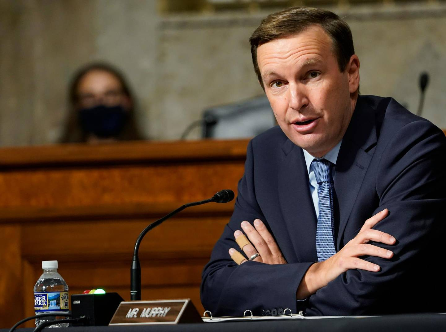 FILE- In this Sept. 24, 2020 file photo, Sen. Chris Murphy, D-Conn., speaks during a Senate Foreign Relations Committee hearing on Capitol Hill in Washington. Murphy and Connecticut Sen. Richard Blumenthal will be self-isolating after a member of Connecticut Gov. Ned Lamont's staff tested positive for COVID-19. Both tweeted on Saturday, Nov. 14, 2020, that they had not had close contact with the staffer but were taking the step out of an abundance of caution. (AP Photo/Susan Walsh, Pool, File)