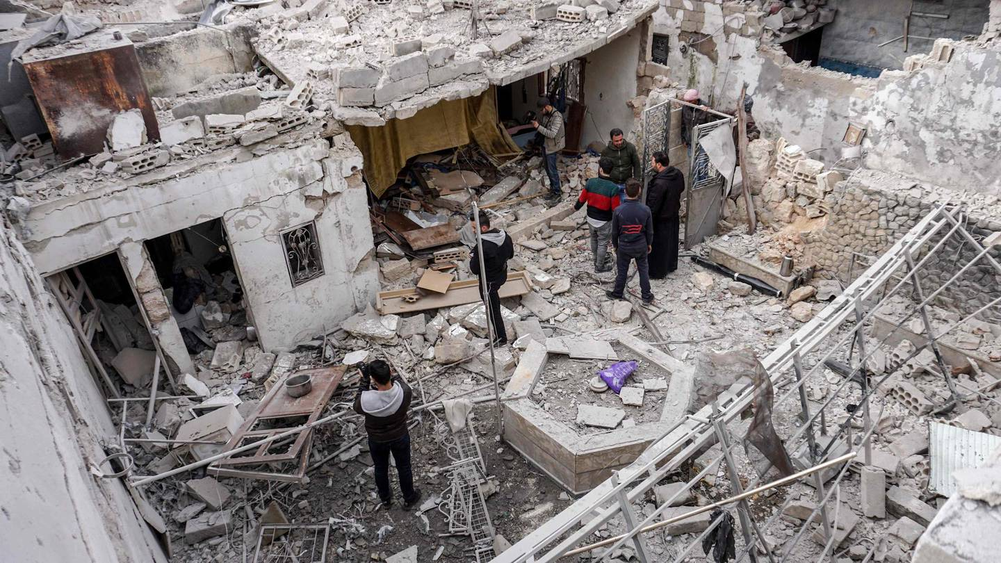 Syrians inspect damage from a reported regime air strike at civilian residence in the town of Saraqib in the northern Idlib province on March 10, 2019.  / AFP / Muhammad HAJ KADOUR