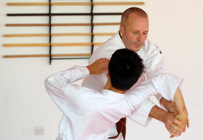 Dubai, United Arab Emirates - July 20, 2019: Chua Ken Yu (L) with Burim Berisha. Cathy Darnell is the only female Aikido instructor in Dubai and is a 4th dan, she has the oldest dojo in the country, Zanshinkan Aikido club Dubai is celebrating our 25th anniversary in 2020. Saturday the 20th of July 2019. Al Barsha, Dubai. Chris Whiteoak / The National