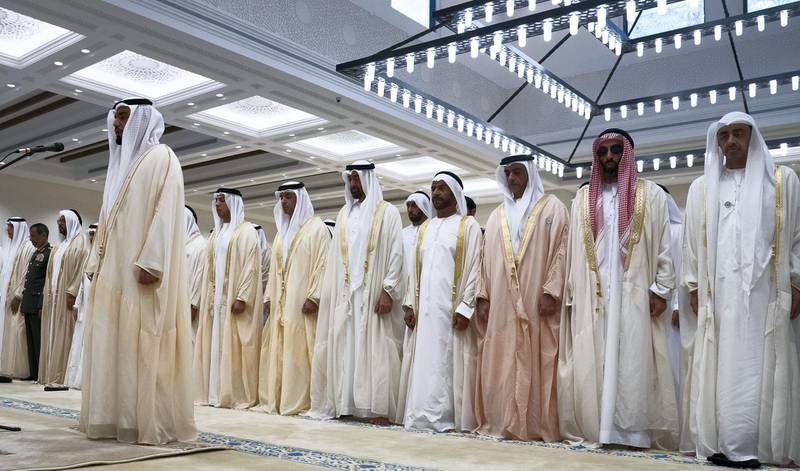 ABU DHABI, UNITED ARAB EMIRATES - August 21, 2018:  HH Sheikh Abdullah bin Zayed Al Nahyan, UAE Minister of Foreign Affairs and International Cooperation (R), HH Sheikh Tahnoon bin Zayed Al Nahyan, UAE National Security Advisor (2nd R), HH Lt General Sheikh Saif bin Zayed Al Nahyan, UAE Deputy Prime Minister and Minister of Interior (3rd R), HH Sheikh Suroor bin Mohamed Al Nahyan (4th R), HH Sheikh Mohamed bin Zayed Al Nahyan Crown Prince of Abu Dhabi Deputy Supreme Commander of the UAE Armed Forces (5th R), HH Sheikh Hazza bin Zayed Al Nahyan, Vice Chairman of the Abu Dhabi Executive Council (6th R) and HH Sheikh Mansour bin Zayed Al Nahyan, UAE Deputy Prime Minister and Minister of Presidential Affairs (7th R), attend Eid Al Adha prayers at the Sheikh Sultan bin Zayed The First mosque.   ( Hamad Al Kaabi / Crown Prince Court - Abu Dhabi ) ---
