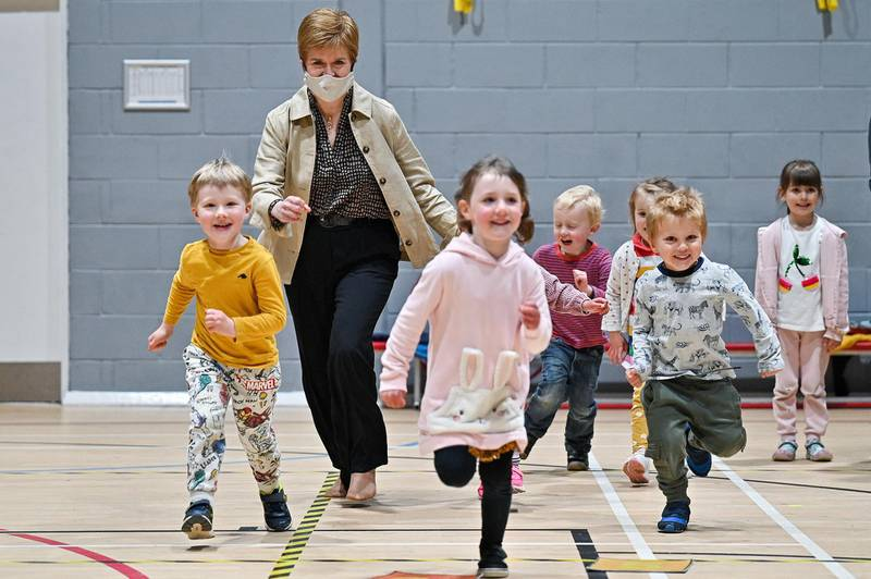 Scotland's First Minister and leader of the Scottish National Party (SNP), Nicola Sturgeon plays with children as she campaigns ahead of the upcoming Scottish Parliament election at the Benachie Leisure Centre in Insch, Scotland, Britain April 29, 2021. Jeff J Mitchell/Pool via REUTERS