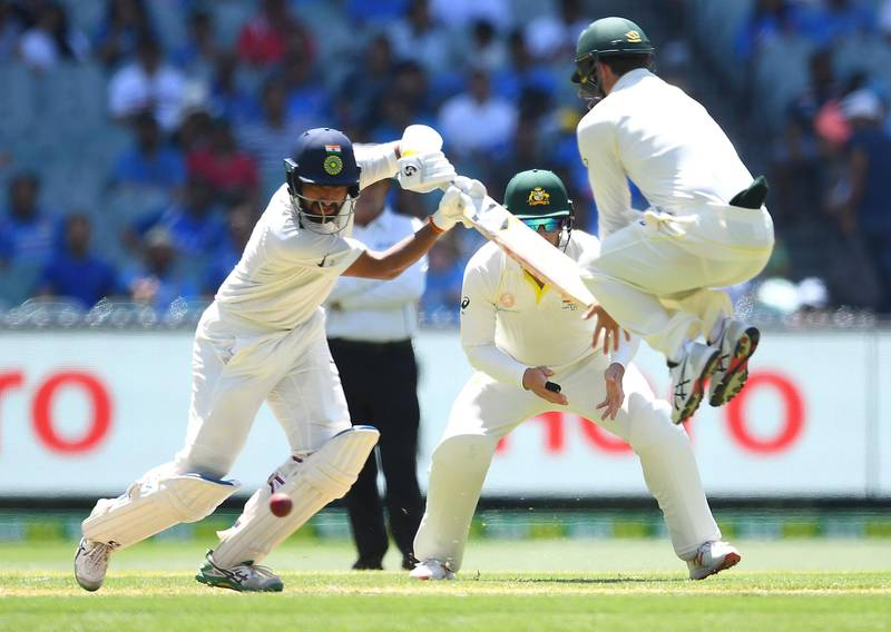 MELBOURNE, AUSTRALIA - DECEMBER 27: Cheteshwar Pujara of India bats as Travis Head of Australia jumps out of the way in the field during day two of the Third Test match in the series between Australia and India at Melbourne Cricket Ground on December 27, 2018 in Melbourne, Australia. (Photo by Quinn Rooney/Getty Images)
