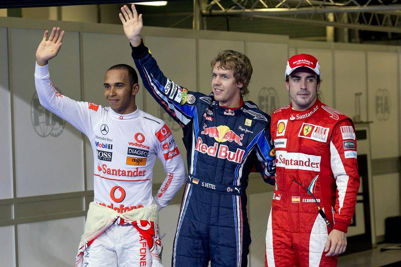 November 13, 2010 - Abu Dhabi, UAE - Red Bull driver Sebastian Vettel of Germany, center, pole position, McLaren Mercedes driver Lewis Hamilton of Britain , left, second fastest time and Ferrari driver Fernando Alonso of Spain, right, third fastest time after the qualifying session at the Yas Marina Circuit.   (Andrew Henderson / The National)