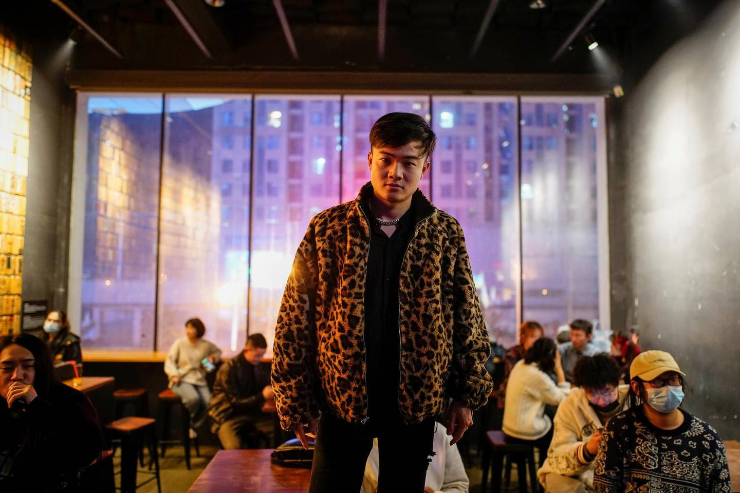 """Zhang Xinghao, lead singer of band Mad Rat, poses for a picture almost a year after the global outbreak of the coronavirus disease (COVID-19) in Wuhan, Hubei province, China December 9, 2020. """"At that time, I couldn't do anything at home. It was very boring, so I thought I needed to write some music and sing some songs to find some fun in my life,"""" Xinghao said. Picture taken December 9, 2020. REUTERS/Aly Song"""