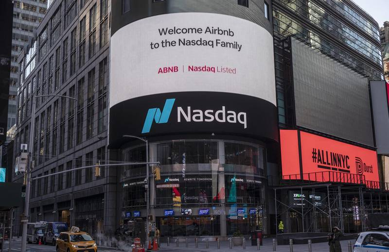 Airbnb Inc. signage on an electronic monitor during the company's initial public offering (IPO) at the Nasdaq MarketSite in New York, U.S., on Thursday, Dec. 10, 2020. Airbnb Inc.priced its long-awaited initial public offering above a marketed range to raise about $3.5 billion, seizing on investor demand for a home-rental business roaring back from a pandemic-fueled slump. Photographer: Victor J. Blue/Bloomberg