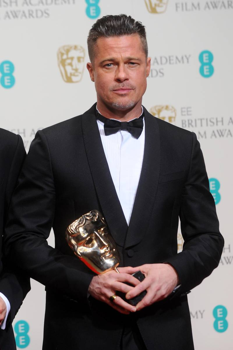 LONDON, ENGLAND - FEBRUARY 16:  Producer and actor Brad Pitt, winner of the Best Film award, poses in the winners room at the EE British Academy Film Awards 2014 at The Royal Opera House on February 16, 2014 in London, England.  (Photo by Anthony Harvey/Getty Images)