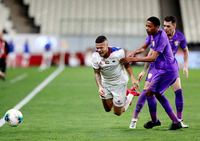 Abu Dhabi, United Arab Emirates - Reporter: John McAuley: Marcus Vinicius of Sharjah takes on Caio and Salem Abdulla (3) of Al Ain in the game between Sharjah and Al Ain in the PresidentÕs Cup semi-final. Tuesday, March 10th, 2020. Mohamed bin Zayed Stadium, Abu Dhabi. Chris Whiteoak / The National