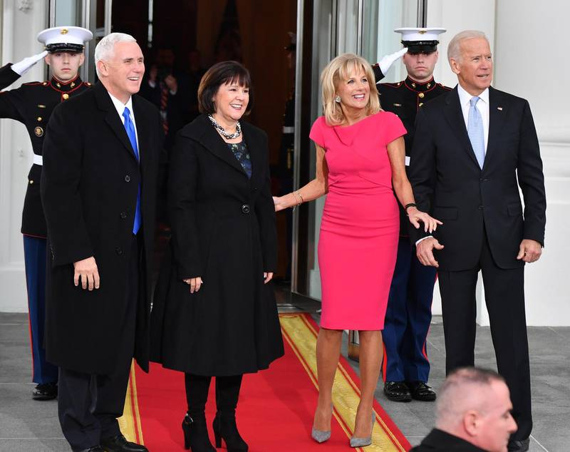 epa05735102 US Vice President Joe Biden (R) and Dr. Jill Biden pose with US Vice President-elect Mike Pence and wife Karen at the White House before the inauguration in Washington, DC, USA, 20 January 2017. Trump won the 08 November 2016 election to become the next US President.  EPA/KEVIN DIETSCH / POOL