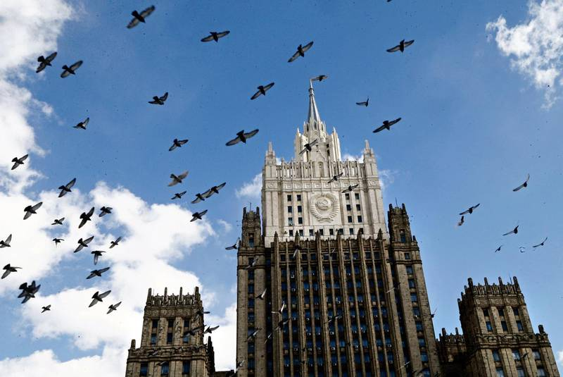 epa06635487 Pigeons fly in front of Russian Foreign Affairs Ministry building in Moscow, Russia, 29 March 2018. Fourteen countries in Europe, USA, Canada and Australia supported the decision of Britain to expel Russian diplomats, more than one hundred all together, related to the the use of a chemical weapon in the attempted murder of Sergei Skripal, a former Russian intelligence official, and his daughter, Yulia, in Salisbury, England, on 04 March 2018.  EPA/MAXIM SHIPENKOV