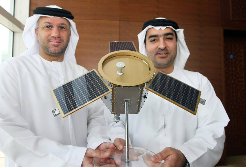 DUBAI. 4th August. 2009. DUBAISAT-1 LAUNCH. His Excellency  Mohamed Al Ghanim, Board Chairman of EIAST (Emirates Institute for Advanced Science and Technology) left and His Excellency Ahmed Al Mansoori, Director General of EIAST,  with a model of the DubaiSat-1 satellite at a press conference in Dubai yesterday(tues) to announce the successful launch of the satelite. Stephen Lock  /  The National .  *** Local Caption ***  SL-satelite-003.jpg
