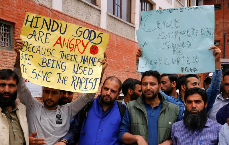 epa06668194 People hold placards during a protest calling for justice in the rape and murder case of eight-year-old girl, in Srinagar, the summer capital of Indian Kashmir, 14 April 2018. According to Police, the nomadic Gujjar child was raped and murdered in Kathua district of Jammu region in January 2018. The Crime Branch of Police has filed a charge sheet of the case in a local court and indicted eight people in the case.  EPA/FAROOQ KHAN