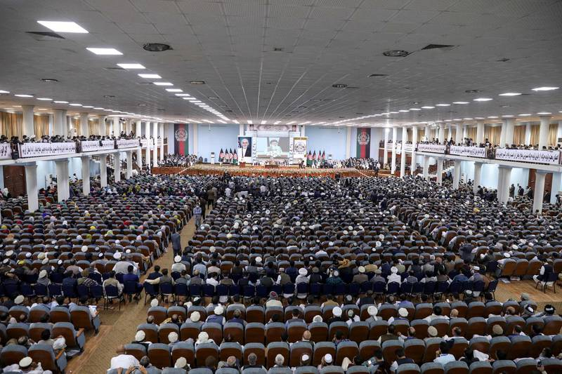 """In this handout photograph taken on August 7, 2020 and released by the Press Office of President of Afghanistan, people attend the first day of the Loya Jirga, a grand assembly, at the Loya Jirga Hall in Kabul. Thousands of Afghans began a three-day gathering in Kabul on August 7 to decide whether to release about 400 Taliban prisoners, including many involved in attacks that killed scores of Afghans and foreigners. - RESTRICTED TO EDITORIAL USE - MANDATORY CREDIT """"AFP PHOTO / PRESS OFFICE OF PRESIDENT OF AFGHANISTAN"""" - NO MARKETING - NO ADVERTISING CAMPAIGNS - DISTRIBUTED AS A SERVICE TO CLIENTS  / AFP / Press Office of President of Afghanistan / - / RESTRICTED TO EDITORIAL USE - MANDATORY CREDIT """"AFP PHOTO / PRESS OFFICE OF PRESIDENT OF AFGHANISTAN"""" - NO MARKETING - NO ADVERTISING CAMPAIGNS - DISTRIBUTED AS A SERVICE TO CLIENTS"""
