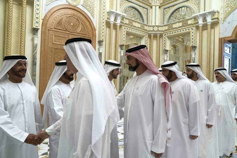 ABU DHABI, UNITED ARAB EMIRATES - May 20, 2018: HH Sheikh Suroor bin Mohamed Al Nahyan (L) greets HH Sheikh Saud bin Rashid Al Mu'alla, UAE Supreme Council Member and Ruler of Umm Al Quwain (1st R) , during an iftar reception at the Presidential Palace. Seen with HH Sheikh Ammar bin Humaid Al Nuaimi, Crown Prince of Ajman (2nd R), HH Sheikh Mohamed bin Hamad Al Sharqi, Crown Prince of Fujairahn (3rd R), HH Sheikh Mohamed bin Saud bin Saqr Al Qasimi, Crown Prince and Deputy Ruler of Ras Al Khaimah (4th R) and HH Sheikh Hamdan bin Rashid Al Maktoum, Deputy Ruler of Dubai and UAE Minister of Finance (5th R).   ( Mohamed Al Hammadi / Crown Prince Court - Abu Dhabi ) ---