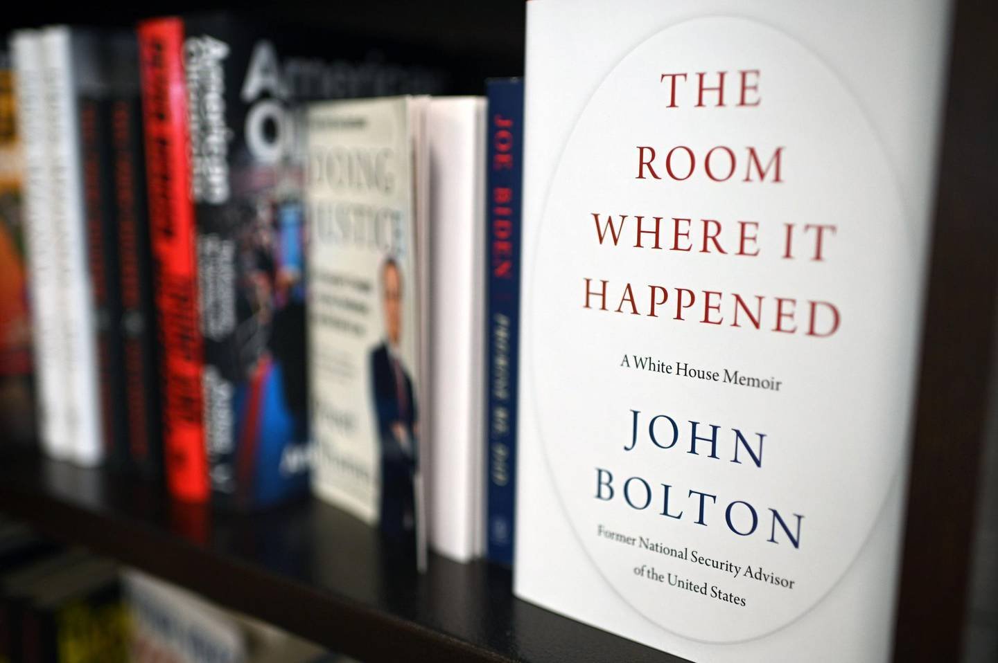 """Copies of the book """"The Room Where it Happened"""" a memoir by former US national security advisor John Bolton are for sale at Barnes & Noble in Glendale, California on June 23, 2020.     The Trump administration tried unsuccessfully to block publication of Bolton's book claiming it contained classified national security information.Former US national security advisor John Bolton said Sunday he thinks North Korean leader Kim Jong Un """"gets a huge laugh"""" over US counterpart Donald Trump's perception of their relationship. Bolton spoke to ABC News for his first interview ahead of the Tuesday release of his tell-all book, which contains many damning allegations against Trump.  / AFP / Robyn Beck"""
