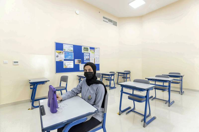 SHARJAH, UNITED ARAB EMIRATES. 05 JANUARY 2021. Just 12 percent of Sharjah pupils have returned to school in the new semester. Partualy empty classes at Al Shola Private School where teachers use an online platform to teach the present pupils while students who opted to stay at home are logged in on the learning platform. An empty grade 10 classroom with only one student present. (Photo: Antonie Robertson/The National) Journalist: Salam Al Amir. Section: National.