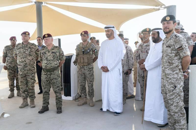 AL DHAFRA REGION, ABU DHABI, UNITED ARAB EMIRATES - June 26, 2019: HRH Hussein bin Abdullah, Crown Prince of Jordan (R), HH Sheikh Tahnoon bin Mohamed Al Nahyan, Ruler's Representative in Al Ain Region (2nd R), HE Lt General Hamad Thani Al Romaithi, Chief of Staff UAE Armed Forces (3rd R), HH Sheikh Mohamed bin Zayed Al Nahyan, Crown Prince of Abu Dhabi and Deputy Supreme Commander of the UAE Armed Forces (4th R) and HM King Abdullah II, King of Jordan (6th R), attend the UAE and Jordan joint military drill, Titled 'Bonds of Strength', at Al Hamra Camp.  ( Rashed Al Mansoori / Ministry of Presidential Affairs ) ---