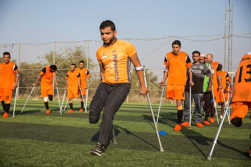 Ball Safi, a new player who just joined , as he is about to bounce the football off his head during a practice session  of Gaza's first amputee football team during a practice session held at the municipal ball field of Deir Al Balah ,Gaza on July 16,2018. Bilal lost his leg in an accident . The team meets weekly and believes they can help spread hope to others with similar injuries to over come their disability .The team dreams to compete internationally .(Photo by Heidi Levine for The National).