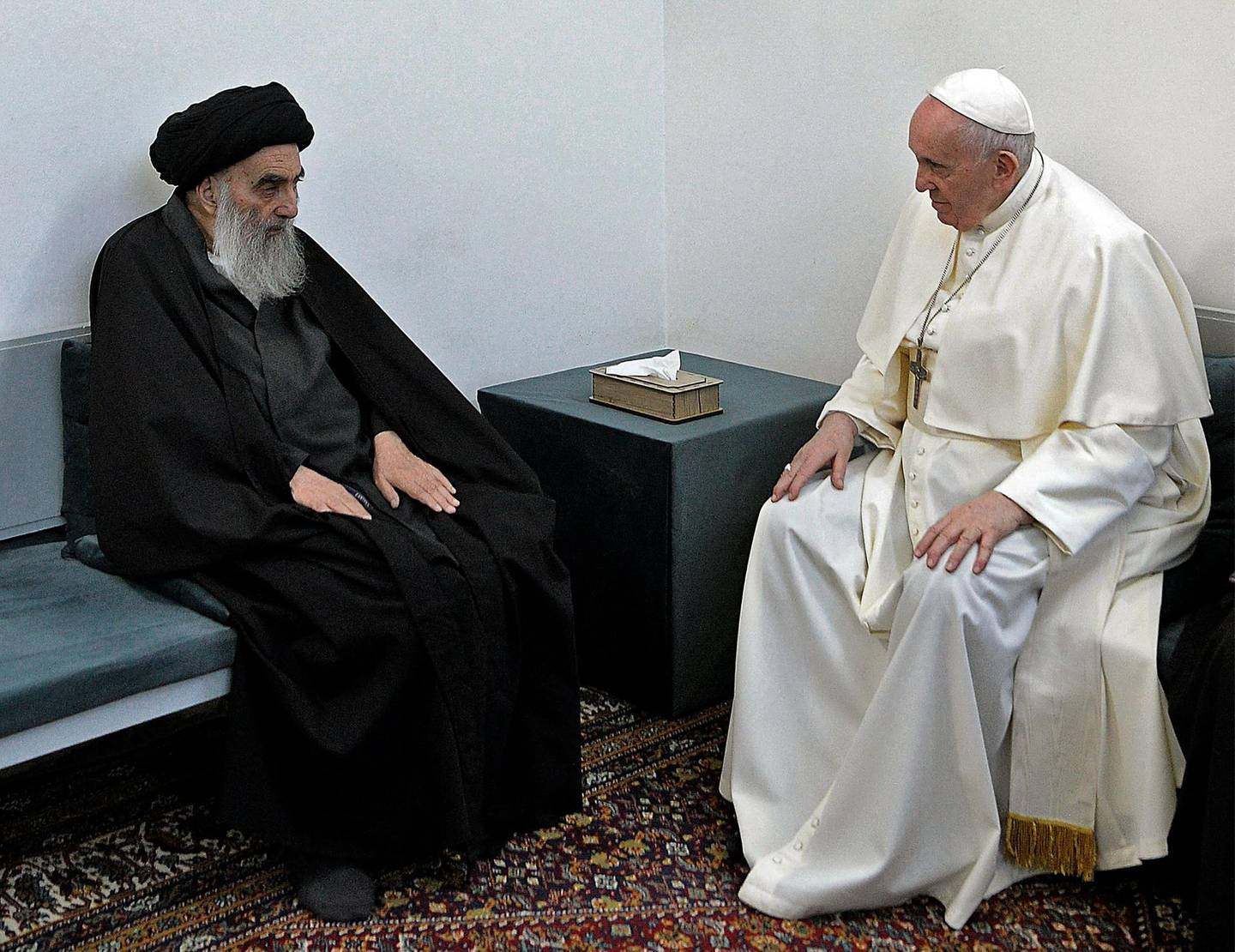 """TOPSHOT - A handout picture provided by the Vatican media office shows Pope Francis meeting top Shiite cleric Grand Ayatollah Ali al-Sistani, in the Iraqi shine city of Najaf, on March 6, 2021. === RESTRICTED TO EDITORIAL USE - MANDATORY CREDIT """"AFP PHOTO / HO / Vatican News"""" - NO MARKETING - NO ADVERTISING CAMPAIGNS - DISTRIBUTED AS A SERVICE TO CLIENTS ===  / AFP / VATICAN MEDIA / STRINGER / === RESTRICTED TO EDITORIAL USE - MANDATORY CREDIT """"AFP PHOTO / HO / Vatican News"""" - NO MARKETING - NO ADVERTISING CAMPAIGNS - DISTRIBUTED AS A SERVICE TO CLIENTS ==="""