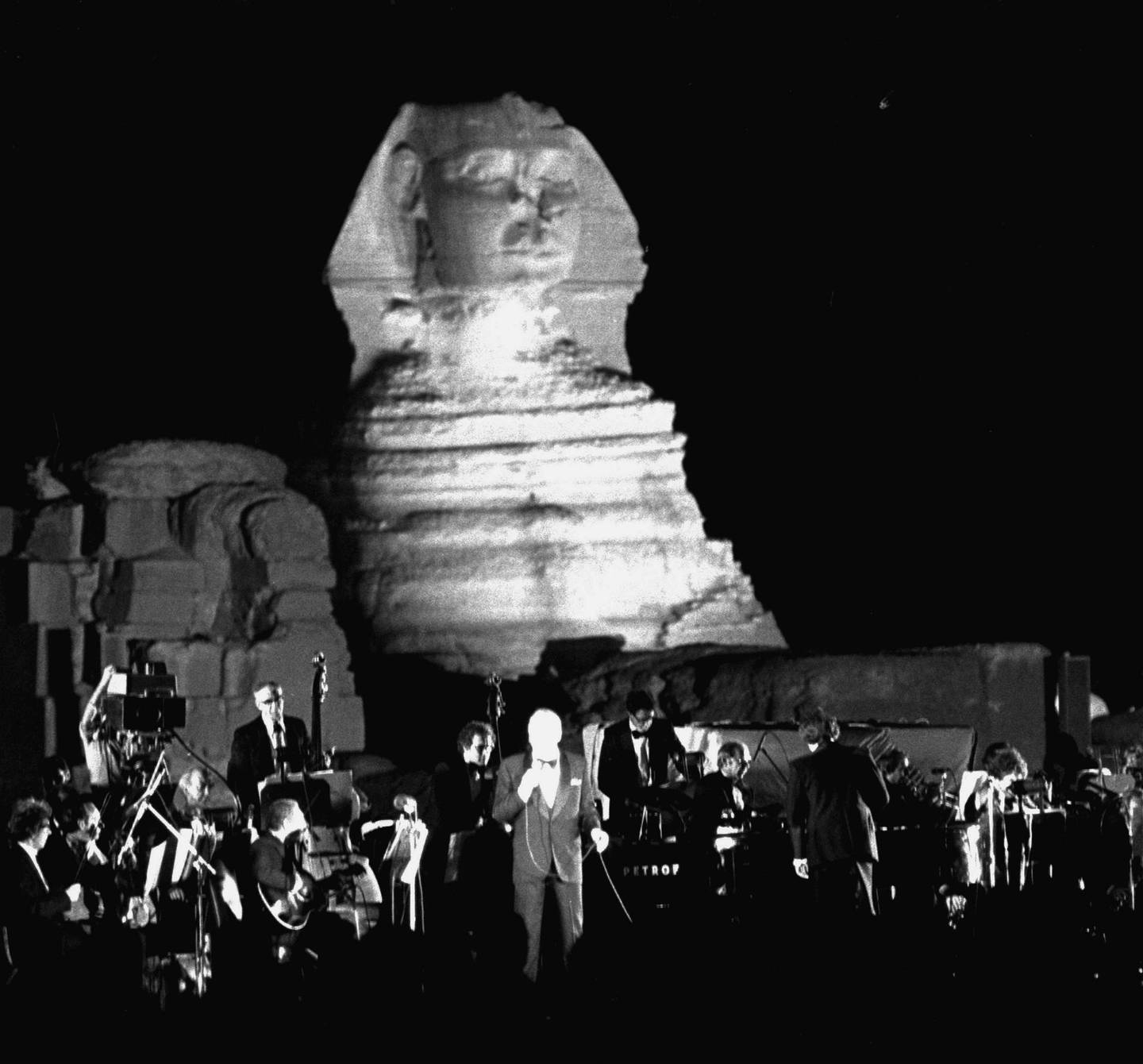 American singer Frank Sinatra is seen during his concert performance in front of the Sphinx in Giza Thursday night, September 27, 1979, in Cairo, Egypt.  Sinatra was invited to perform at the benefit concert for the Wafa Amal rehabilitation center for handicapped children by Egypt's First Lady, Jihan Sadat. (AP Photo/Bill Foley)