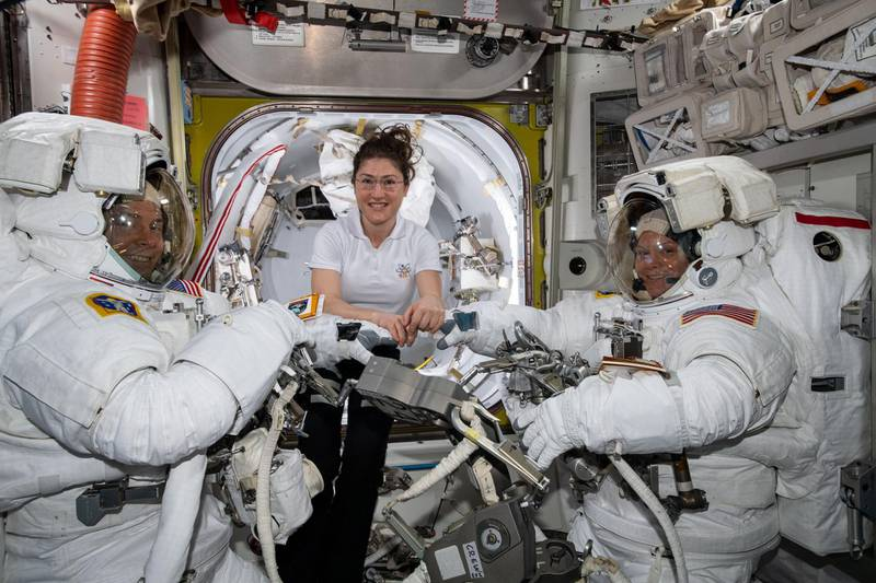 epa07464211 A handout photo made available by the NASA shows NASA astronaut Christina Koch (C) assists fellow astronauts Nick Hague (L) and Anne McClain (R) in their US spacesuits shortly before they begin the first spacewalk of their careers, aboard the International Space Station (ISS), 22 March 2019 (issued 26 March 2019). The NASA on 26 March 2019 said it has cancelled the first all-female spacewalk which was scheduled for 29 March 2019, citing spacesuit issues.  EPA/NASA / HANDOUT  HANDOUT EDITORIAL USE ONLY/NO SALES