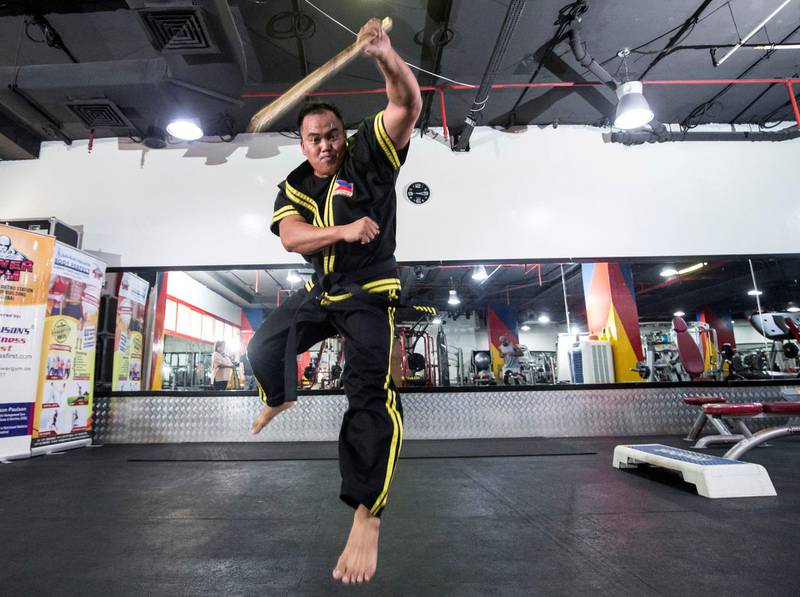 Dubai UNITED ARAB EMIRATES - Guro Omar , a Filipino eskrima giving instructions to his students at Power Gym in Dubai.  Ruel Pableo for The National for Nick's story