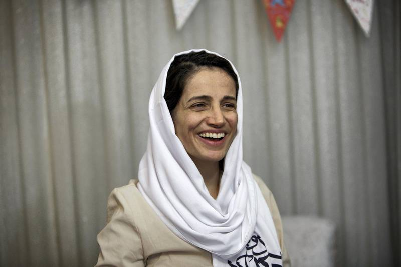"""Iranian lawyer Nasrin Sotoudeh smiles at her home in Tehran on September 18, 2013, after being freed following three years in prison. Sotoudeh told AFP she was in """"good"""" physical and psychological condition, and pledged to continue her human rights work. Her release came a week before Iran's new moderate President Hassan Rowhani, who has promised more freedoms at home and constructive engagement with the world, travels to New York to attend the United Nations General Assembly.  AFP PHOTO/BEHROUZ MEHRI (Photo by BEHROUZ MEHRI / AFP)"""