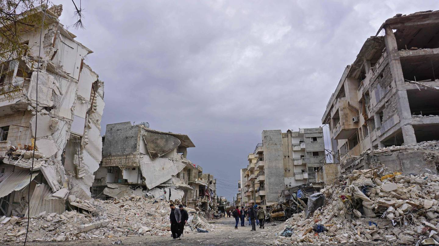 TOPSHOT - This picture taken on March 14, 2019, shows destructions following an airstrike in the jihadist-held city of Idlib, northwestern Syria. Russian air strikes killed at least 13 civilians, including six children, on March 14 in Idlib province, in the first such raids since a September truce deal, a monitor said. The Britain-based Syrian Observatory for Human Rights said around 60 people were also wounded in the air strikes that struck several areas in the northwestern province, which is Syria's last major rebel bastion. / AFP / Muhammad HAJ KADOUR