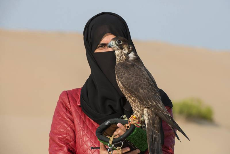 Emirati Ayesha Al Mansoori , pioneer in falconry and head trainer in Abu Dhabi Falcon Club.Ayesha says modern gadgets like binoculars is not neccessary for Emiratis to trace the birds during hunting session , our DNA is all about desert and falcons from generation to generation.Vidhyaa for The National