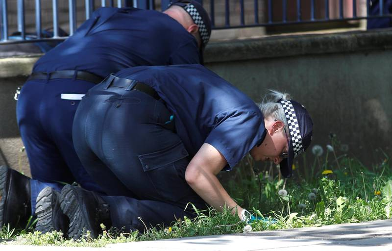 Police officers search for evidence at the scene where a teenager was found after being shot on Saturday, in London, Britain May 6, 2018.  REUTERS/Peter Nicholls