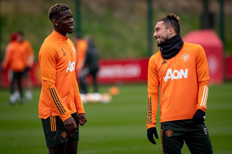 MANCHESTER, ENGLAND - MARCH 16: (EXCLUSIVE COVERAGE) Paul Pogba and Alex Telles of Manchester United in action during a first team training session at Aon Training Complex on March 16, 2021 in Manchester, England. (Photo by Ash Donelon/Manchester United via Getty Images)
