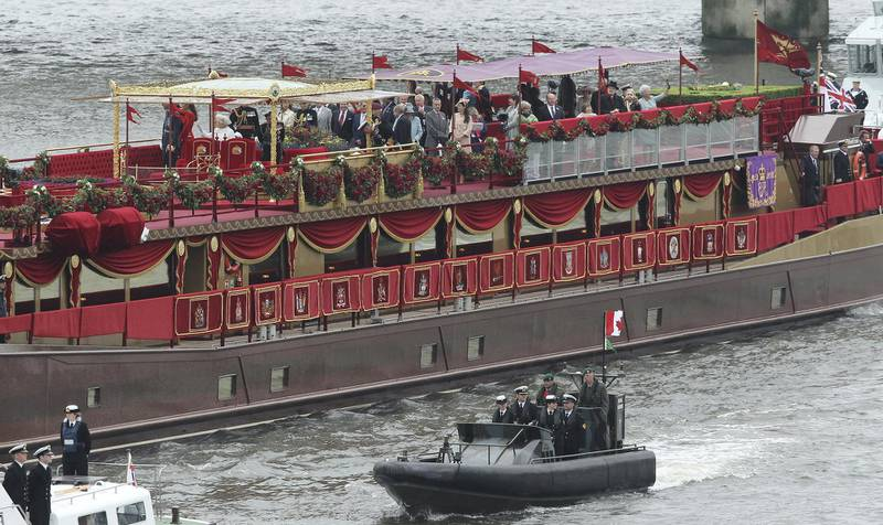 LONDON, ENGLAND - JUNE 03:  The Spirit of Chartwell, the ship carrying Queen Elizabeth II and members of the royal family, travels along the Thames during the River Pageant of the Diamond Jubilee on June 3, 2012 in London, England. For only the second time in its history the UK celebrates the Diamond Jubilee of a monarch. Her Majesty Queen Elizabeth II celebrates the 60th anniversary of her ascension to the throne. Thousands of well-wishers from around the world have flocked to London to witness the spectacle of the weekend's celebrations. The Queen, along with all members of the royal family, will participate in a River Pageant with a flotilla of a 1,000 boats accompanying them down the Thames, a star studded free concert at Buckingham Palace and a carriage procession and a service of thanksgiving at St Paul's Cathedral.  (Photo by Sean Gallup/Getty Images)