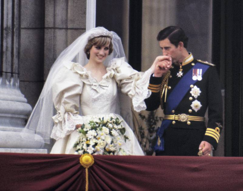 The Prince and Princess of Wales on the balcony of Buckingham Palace on their wedding day, 29th July 1981. Diana wears a wedding dress by David and Elizabeth Emmanuel and the Spencer family tiara. (Photo by Terry Fincher/Princess Diana Archive/Getty Images)