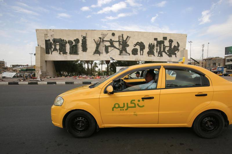 TO GO WITH AFP SPECIAL ABOUT KARIM TAXI (Photo by AHMAD AL-RUBAYE / AFP)
