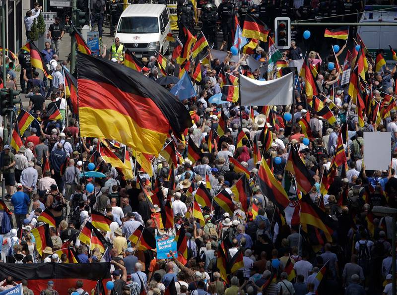AfD supporters march in Berlin, Germany, Sunday, May 27, 2018. The AfD that swept into Parliament last year on a wave of anti-migrant sentiment is staging a march Sunday through the heart of Berlin to protest against the government. (AP Photo/Markus Schreiber)