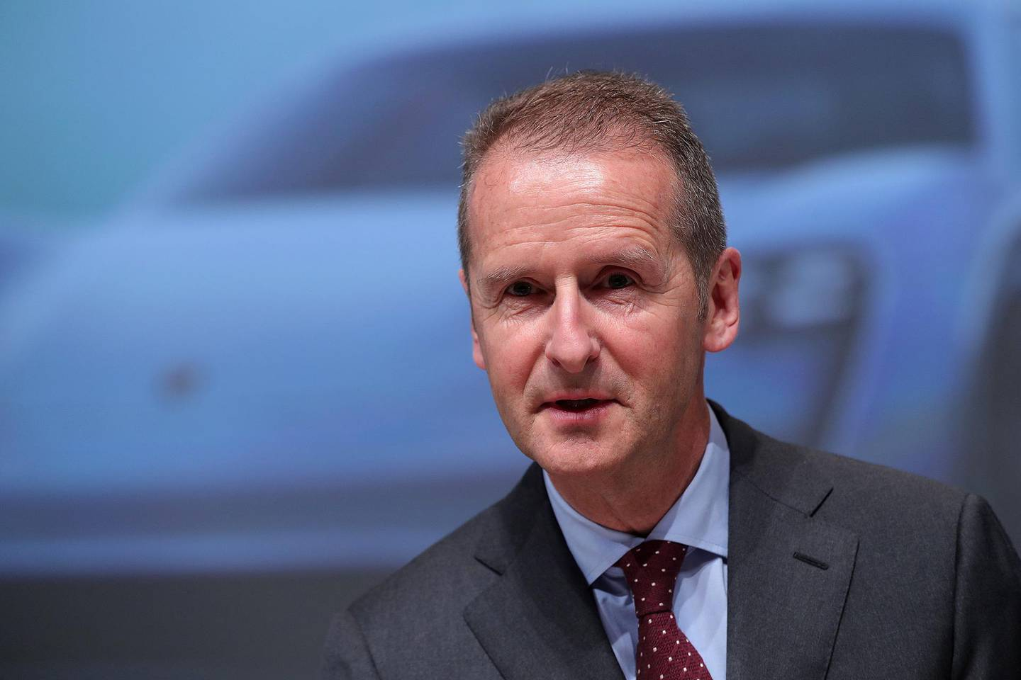 Herbert Diess, chief executive officer of Volkswagen AG (VW), speaks during the automaker's annual general meeting in Berlin, Germany, on Thursday, May 3, 2018. Diess pledged to step up integrity and compliance efforts as part of the German manufacturer's deepest overhaul since the diesel-emissions scandal came to light in 2015. Photographer: Krisztian Bocsi/Bloomberg