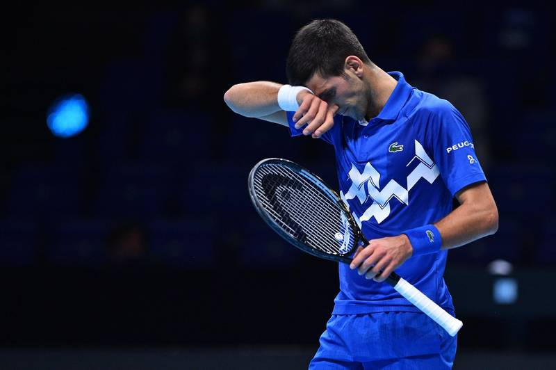 Serbia's Novak Djokovic reacts during his match agaainst Russia's Daniil Medvedev during their men's singles round-robin match on day four of the ATP World Tour Finals tennis tournament at the O2 Arena in London on November 18, 2020.  / AFP / Glyn KIRK