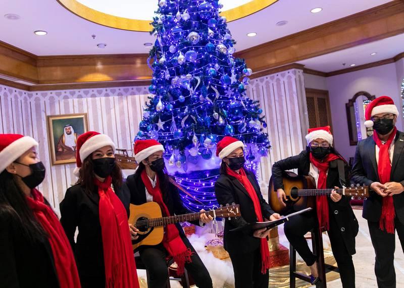 DUBAI, UNITED ARAB EMIRATES. 20 DECEMBER 2020. Christmas carol at Radisson Blu Hotel, Dubai Deira Creek.(Photo: Reem Mohammed/The National)Reporter: Patrick RyanSection: