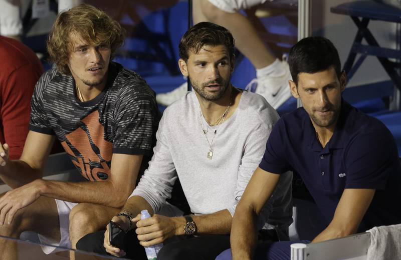 epa08485621 (L-R) Alexander Zverev of Germany,Grigor Dimitrov of Bulgaria and Novak Djokovic of Serbia watch the final match between Filip Krajinovic of Serbia and Dominic Thiem of Austria at the Adria Tour tennis tournament in Belgrade, Serbia, 14 June 2020. The Adria Tour will be held until 05 July in a number of Balkan countries.  EPA/ANDREJ CUKIC