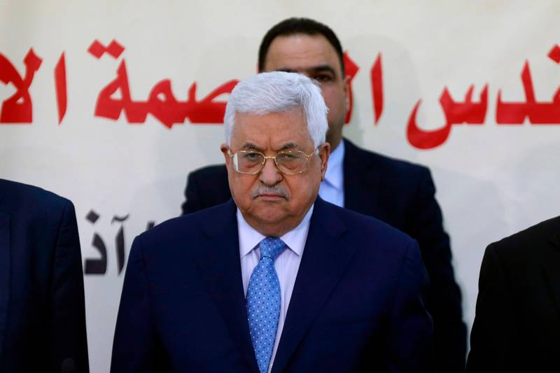 (FILES) In this file photo taken on March 01, 2018 President Mahmud Abbas (C) attends a meeting with the Revolutionary Council of the ruling Fatah party in the West Bank city of Ramallah.  Palestinian president Mahmud Abbas directly accused Hamas on March 19, 2018 of carrying out a bomb attack against prime minister Rami Hamdallah in Gaza last week, threatening fresh sanctions against them. / AFP PHOTO / ABBAS MOMANI