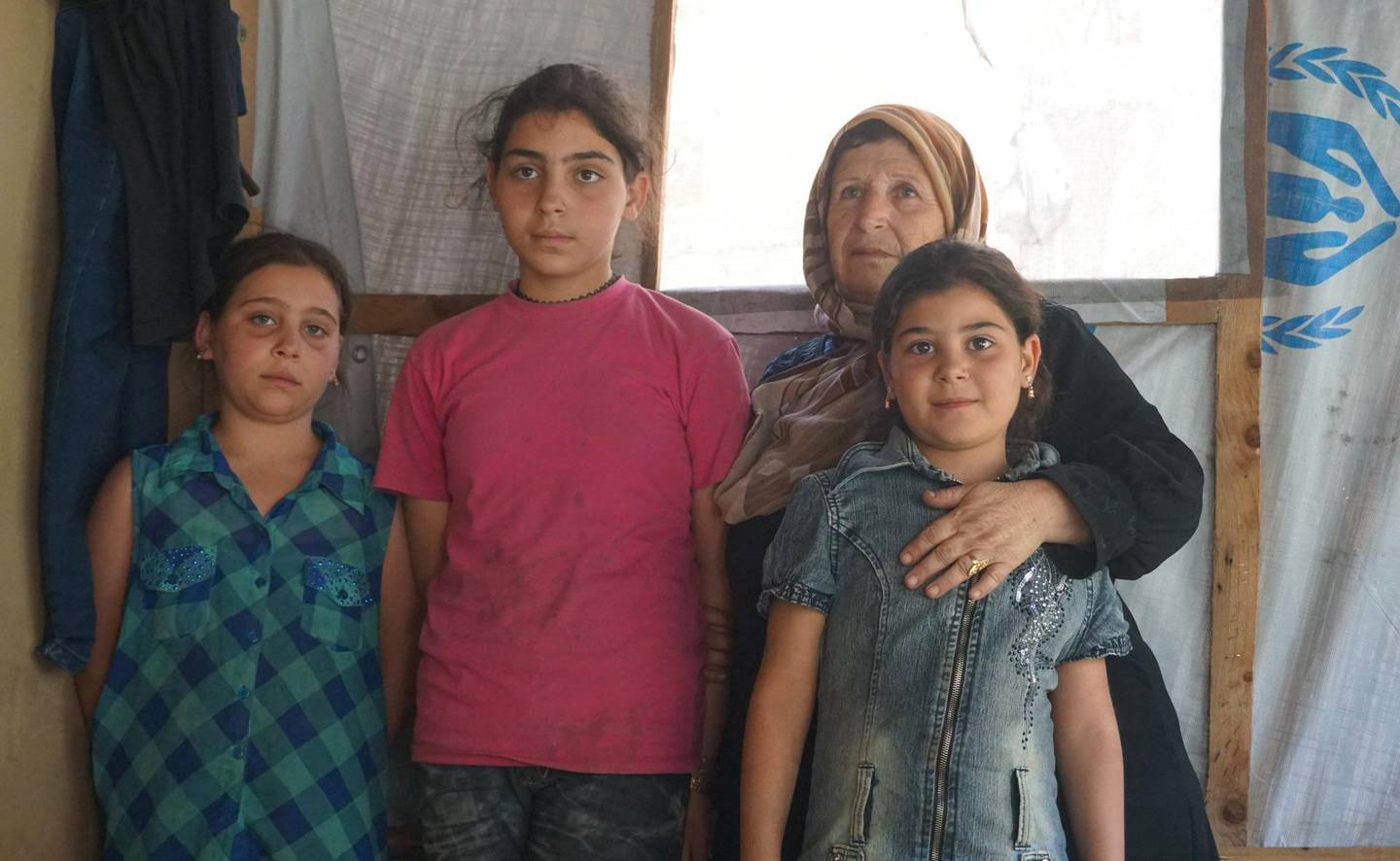 Sobhieh Shakr Alia and her granddaughters inside their home before its destruction in Qarya Hayat camp, Arsal. Sunniva Rose / The National