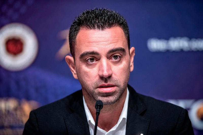 Al Sadd SC Manager Xavier Hernández Creus, also known as Xavi, speaks to the media after receiving the Asian Football Confederation (AFC) Men's Player of the Year 2019 award in place of absentee Akram Afif, during a press conference after the AFC Annual Awards ceremony in Hong Kong on December 2, 2019. / AFP / Philip FONG