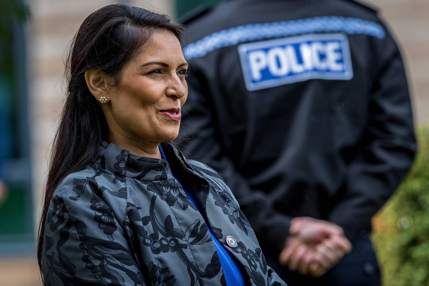 Britain's Home Secretary Priti Patel visits the North Yorkshire Police headquarters in Northallerton, northeast England on July 30, 2020. / AFP / POOL / Charlotte Graham