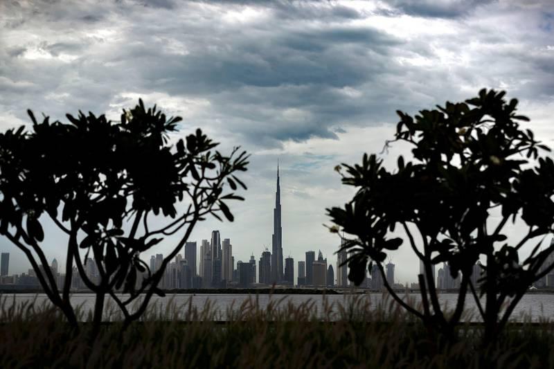 Dubai, United Arab Emirates - Reporter: N/A: Weather. Dramatic skies over the Dubai skyline including the Burj Khalifa after heavy rain. Saturday, March 21st, 2020. Dubai Creek Harbour, Dubai. Chris Whiteoak / The National
