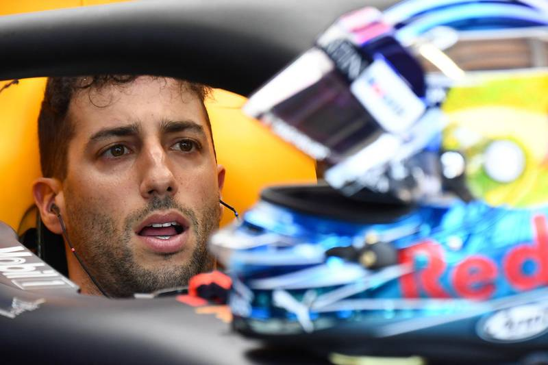 Red Bull Racing's Australian driver Daniel Ricciardo sits in his car in the pits during the third practice session at the Monaco street circuit on May 26, 2018 in Monaco, ahead of the Monaco Formula 1 Grand Prix. / AFP / Boris HORVAT