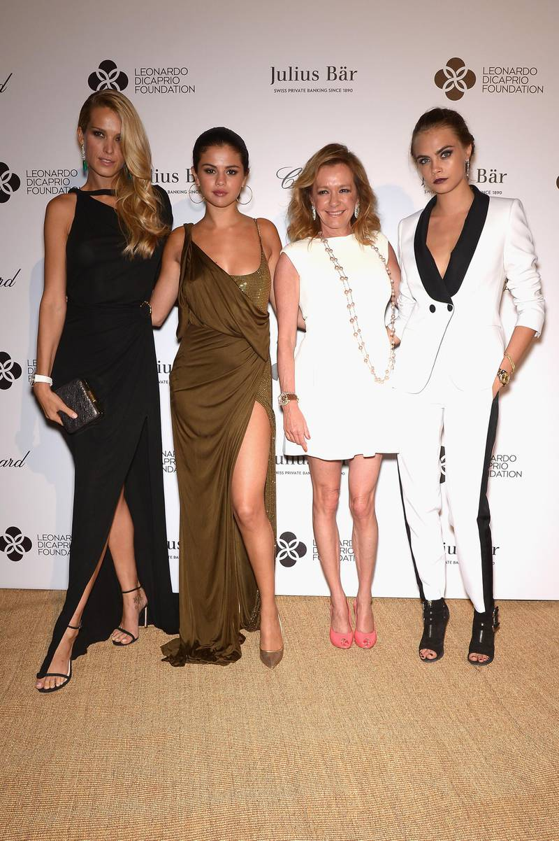 SAINT-TROPEZ, FRANCE - JULY 23:   In this handout provided by the Leonardo Dicaprio Foundation, (L-R) Petra Nemcova, Selena Gomez, Caroline Scheufele and Cara Delevingne attend the Leonardo Dicaprio Foundation Launch at Domaine Bertaud Belieu on July 23, 2014 in Saint-Tropez, France.  (Photo by Dominique Charriau/Getty Images For LDC Foundation)