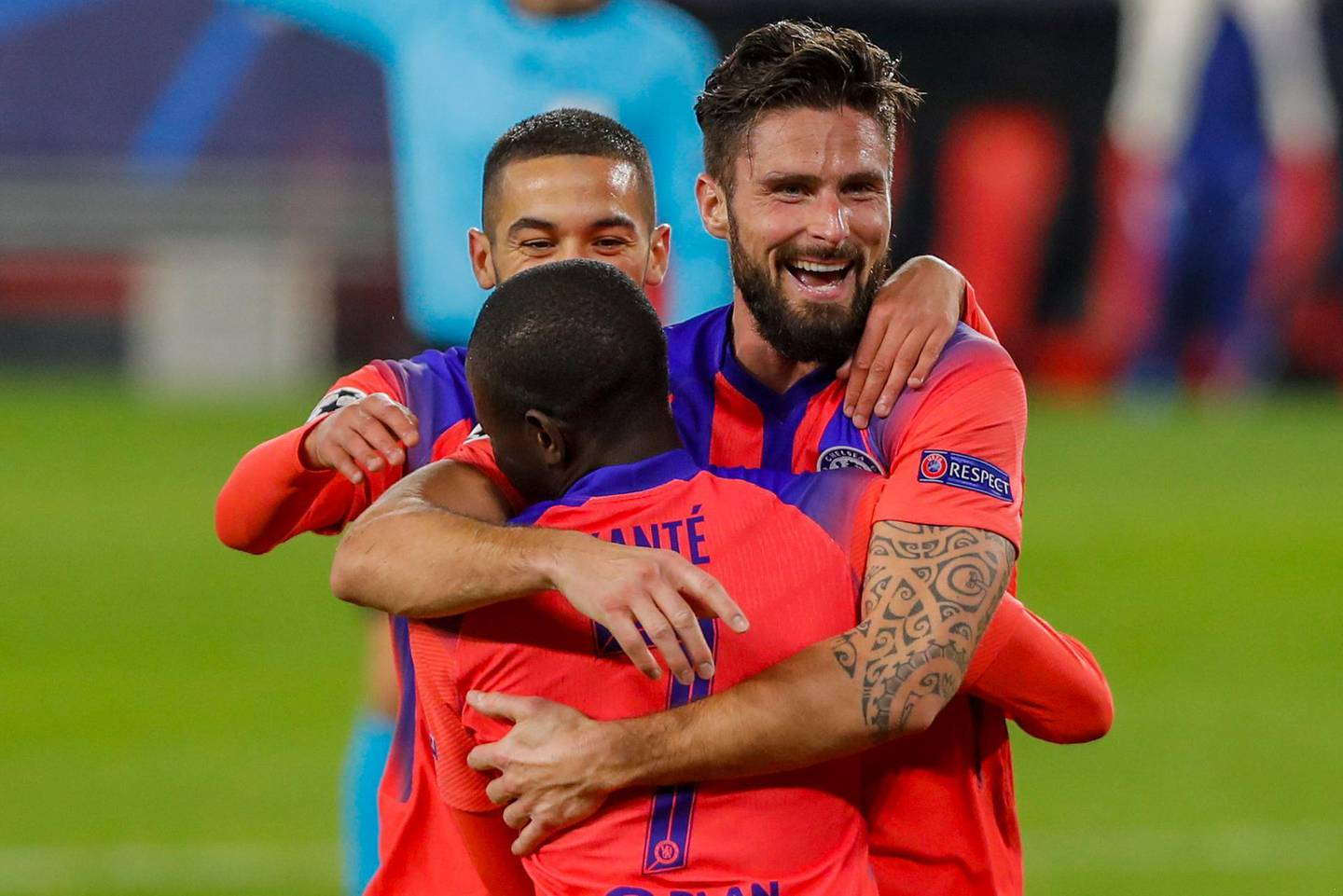 Chelsea's Olivier Giroud celebrates after scoring his side's third goal with teammates during the Champions League group E soccer match between Sevilla and Chelsea at the Ramon Sanchez Pijuan stadium in Seville, Spain, Wednesday, Dec. 2, 2020. (AP Photo/Angel Fernandez)